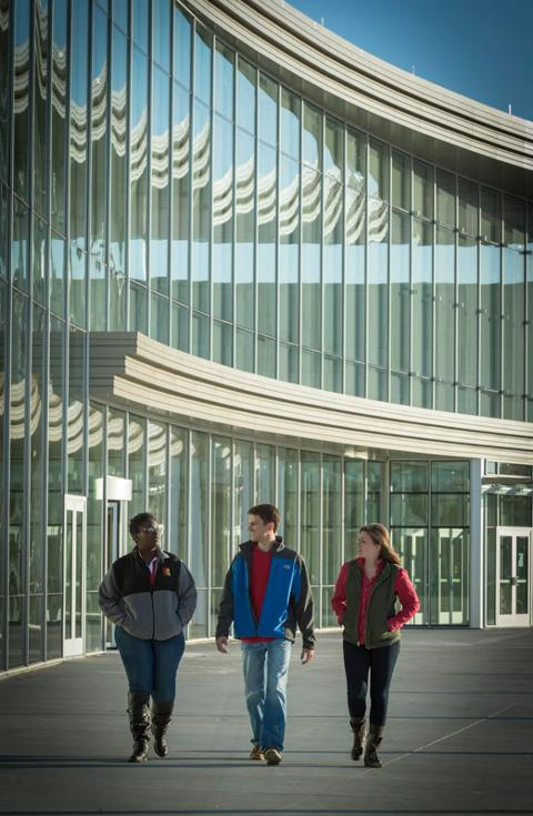 Three students walking in front of the Bicknell